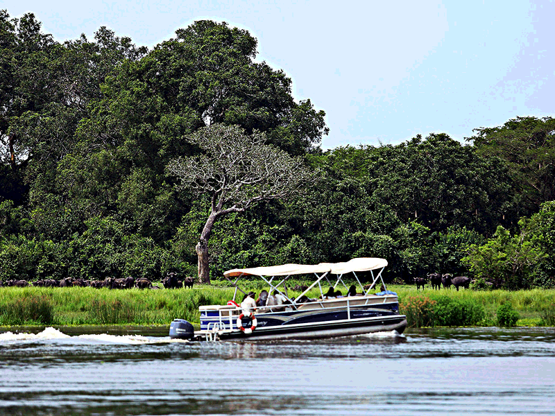 Tourists on a Nile River safari in Murchison Falls National Park, Uganda
